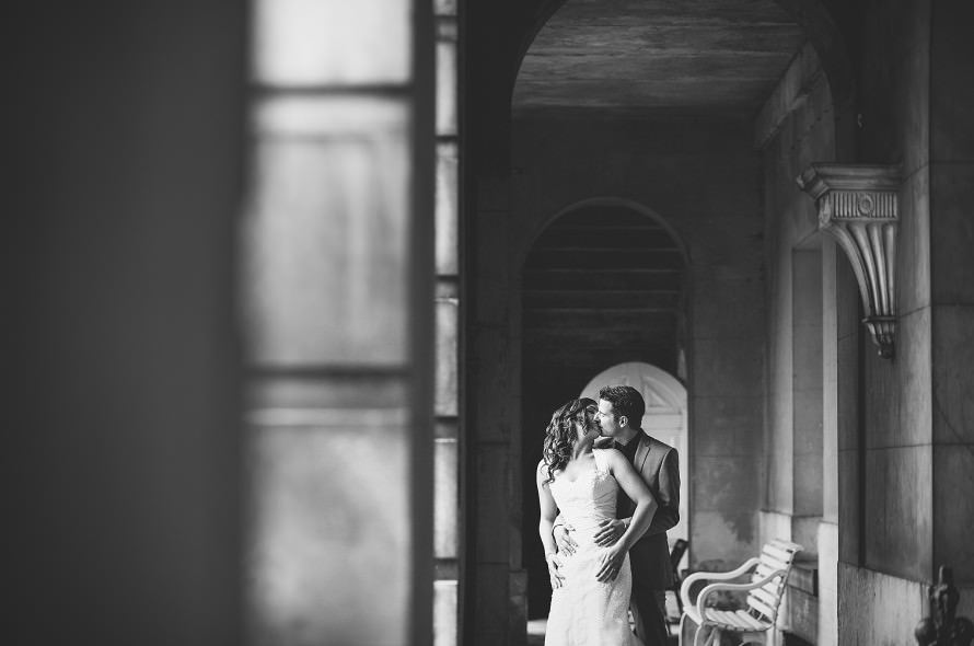 A bride and groom kissing in the grounds of Wolterton Hall wedding venue in Norfolk