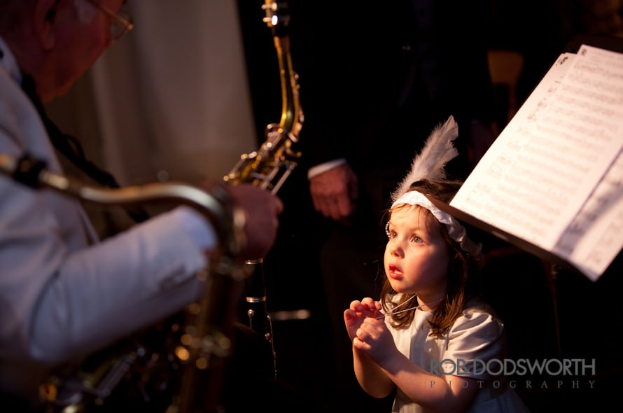 Flower girl at wedding asks the band for more music