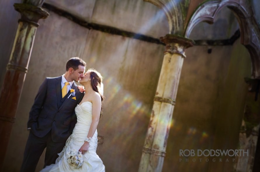 Bride and Groom sharing a kiss in a Gazebo