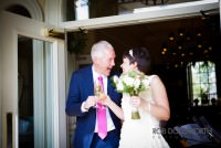 Bride and groom sharing champagne at Washingborough Hall Hotel