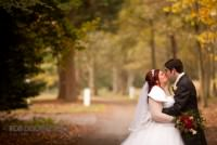 Bride and Groom kissing at an Autumn wedding in Norfolk