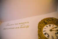A golden clock on the wall at Seckford Hall wedding venue