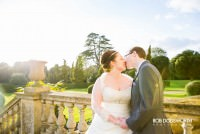 Bride and Groom sharing a kiss at their wedding in the gardens of Ickworth House