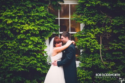 Bride and Groom embrace outside the Norfolk Mead Hotel