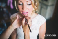 Bride having her make up applied at Chaucer Barn in Norfolk