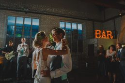 A bride and groom's first dance at Trinity Buoy Wharf