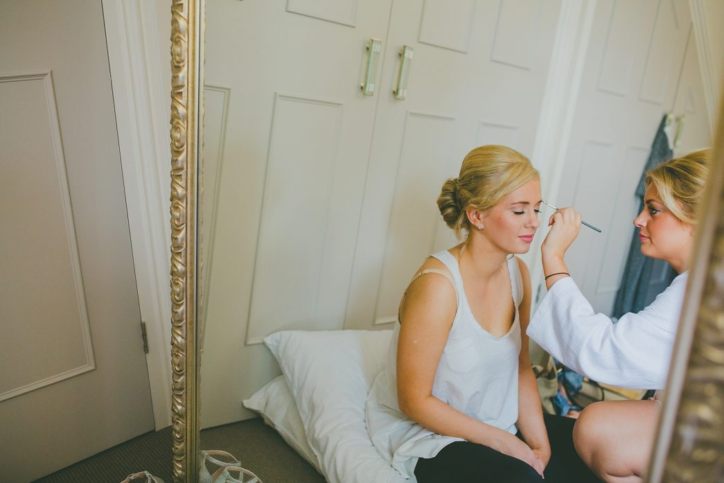 bridesmaids doing their make-up
