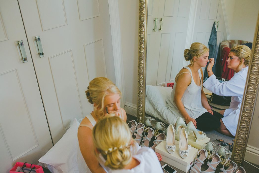 bridesmaids applying make-up