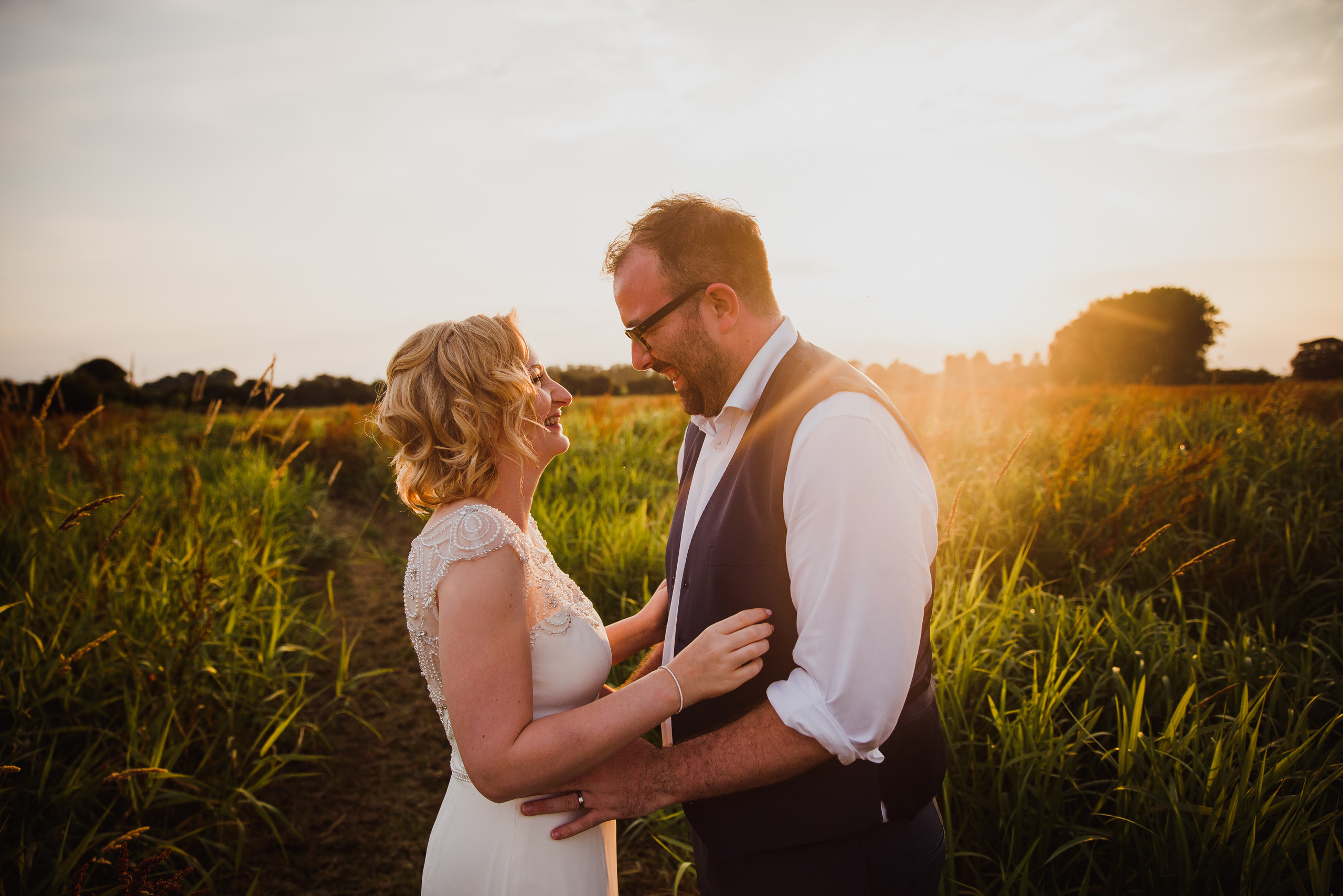Bride and Groom portrait in the grounds of Hautbois Hall at sunset