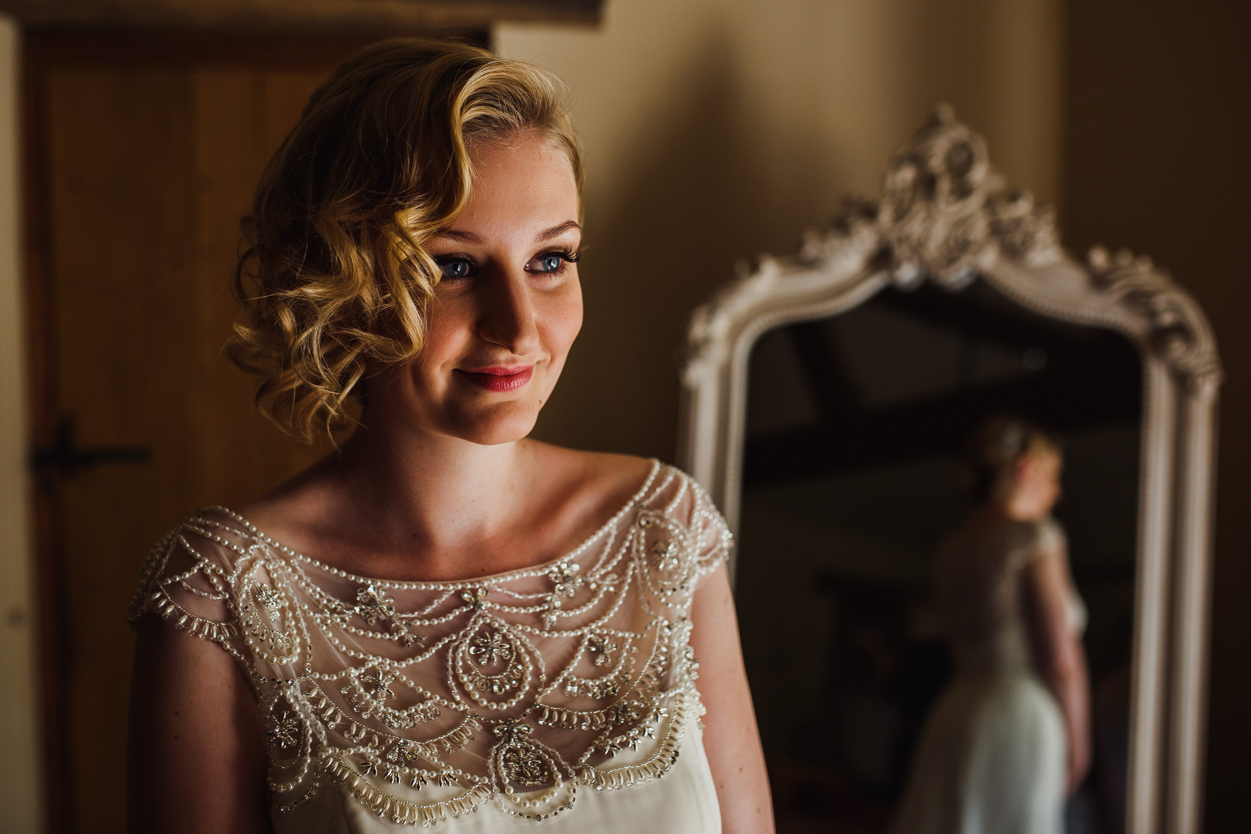 Portrait of a bride getting ready at Hautbois Hall Wedding