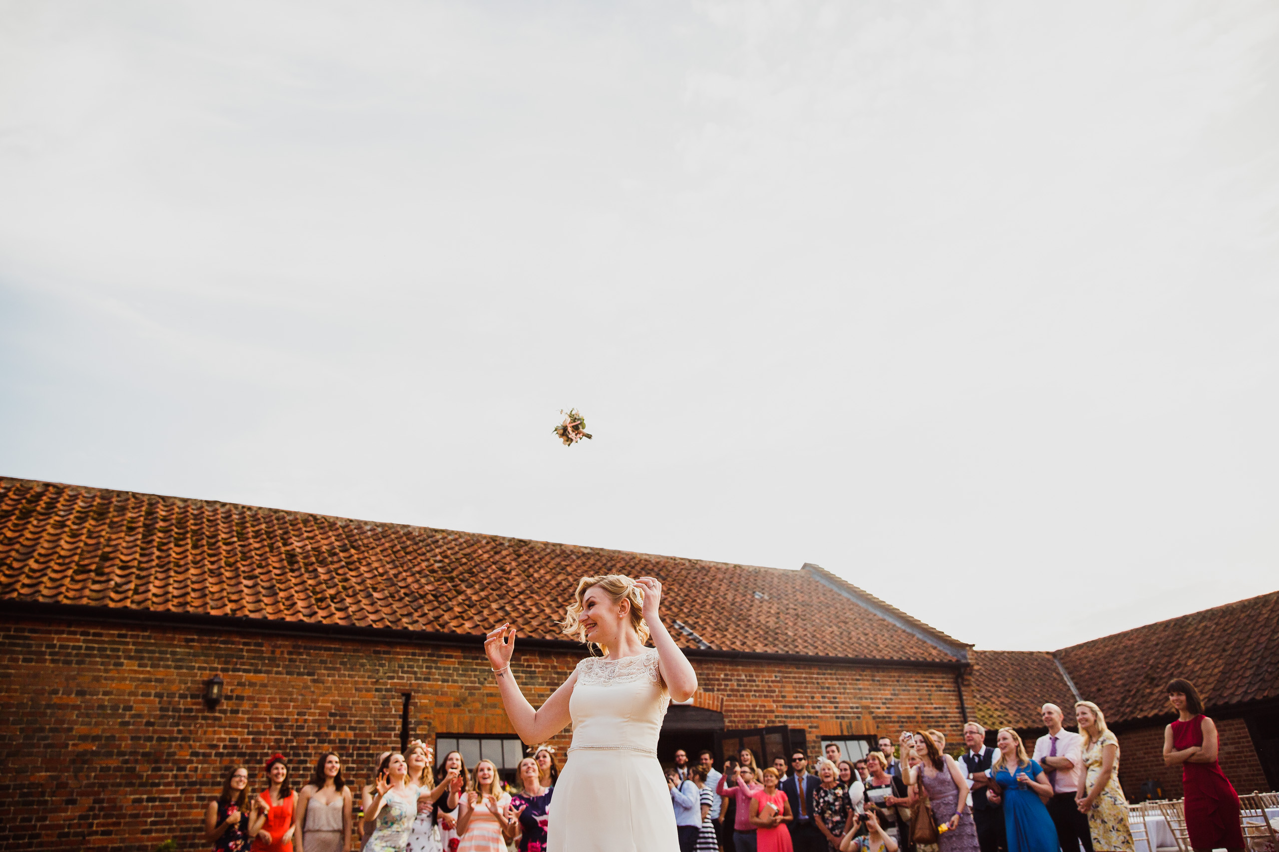 Bride tosses bouquet at Hautbois Hall wedding