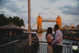 Newlyweds looking at Tower Bridge