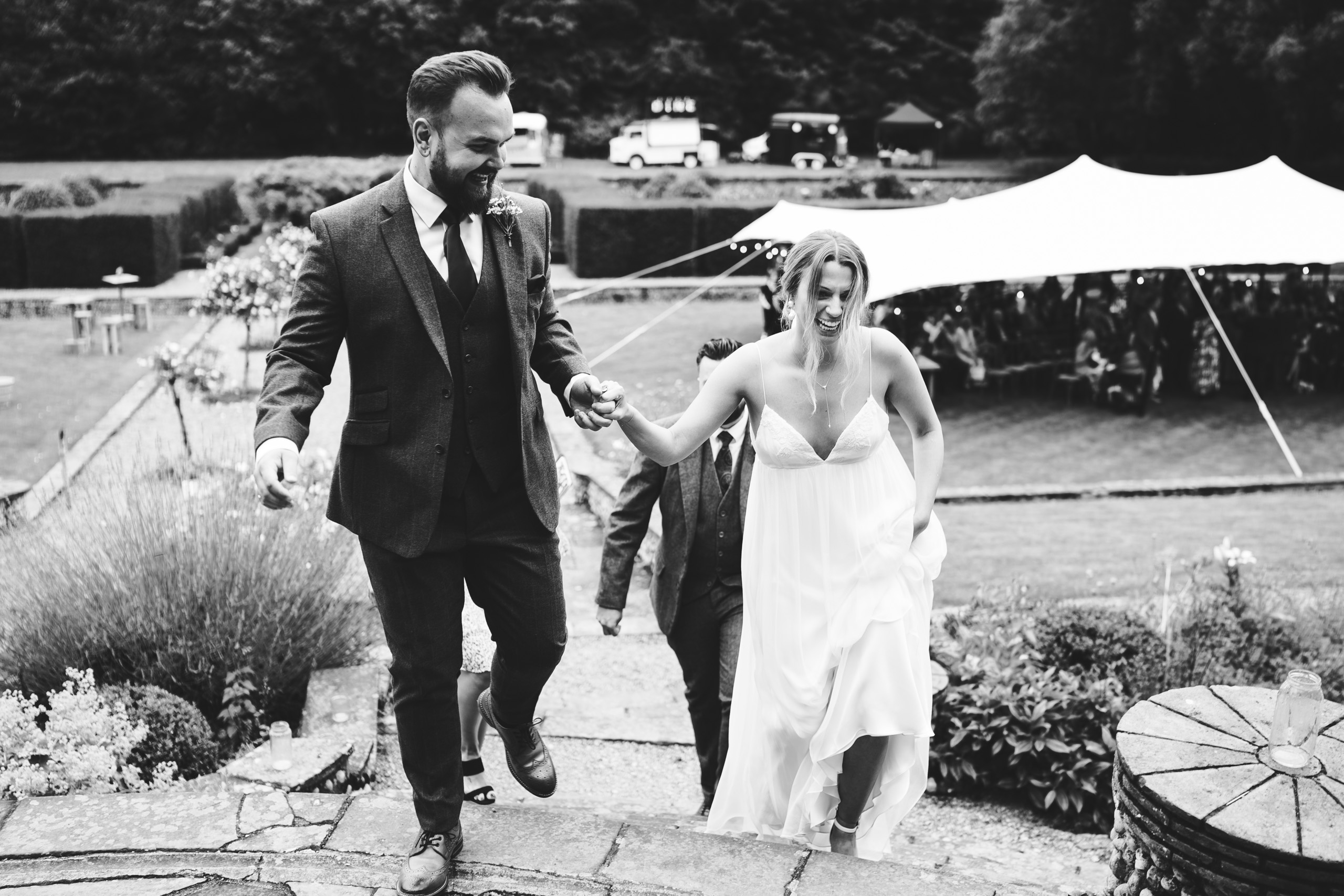 Bride and Groom alight the steps to Voewood wedding venue