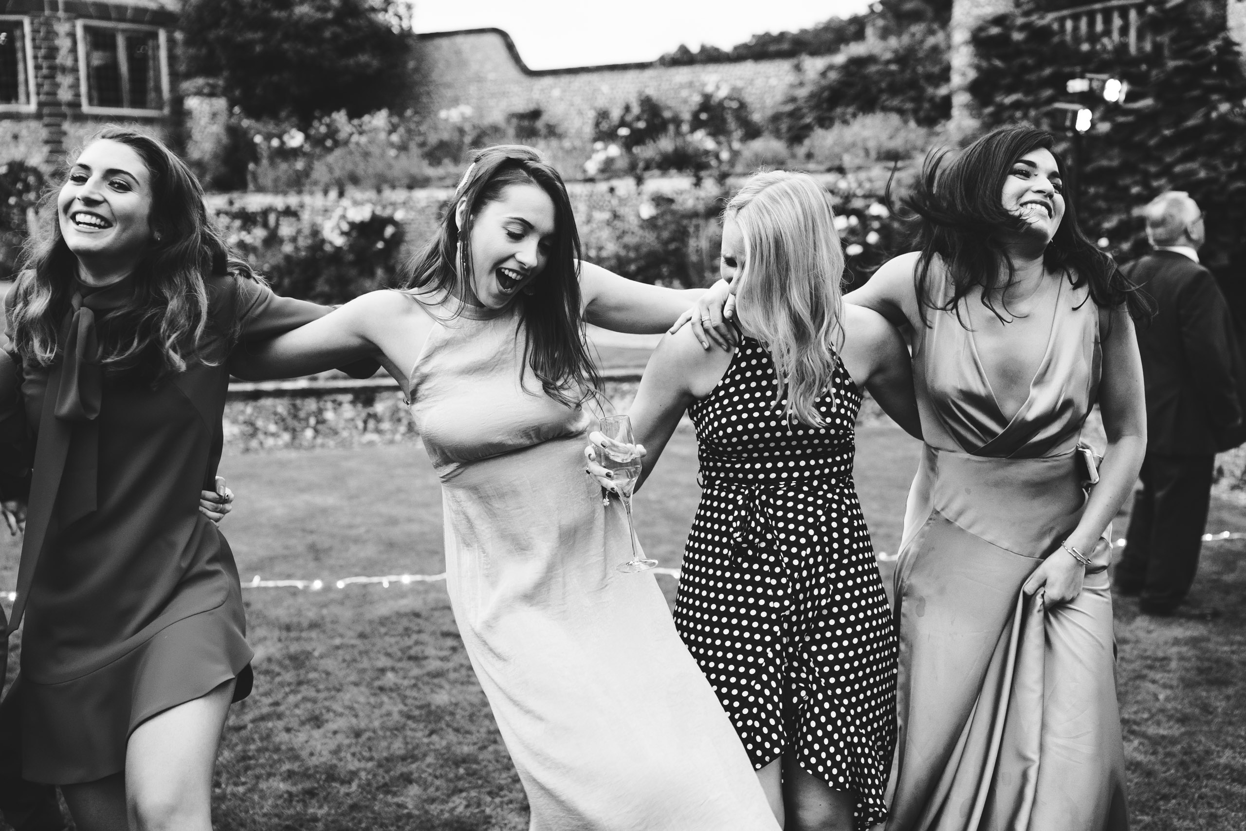 black and white photography of guests dancing at a Norfolk wedding