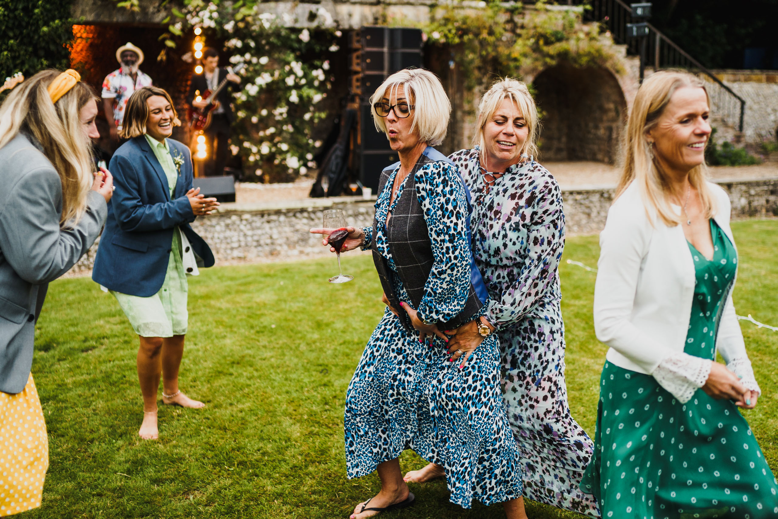 guests dancing in the gardens at a voewood wedding