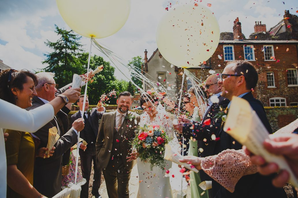 Bride and Groom showered with Confetti at a Norfolk Wedding