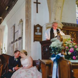 A couple getting married in a North Norfolk church