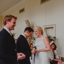 Bride and Groom exchanging rings at wedding in North Norfolk