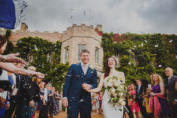 Bride and Groom exit Narborough Hall to a shower of confetti and congratulations