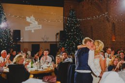 A bride and groom embrace at Sothwood Hall barn wedding venue near Norwich