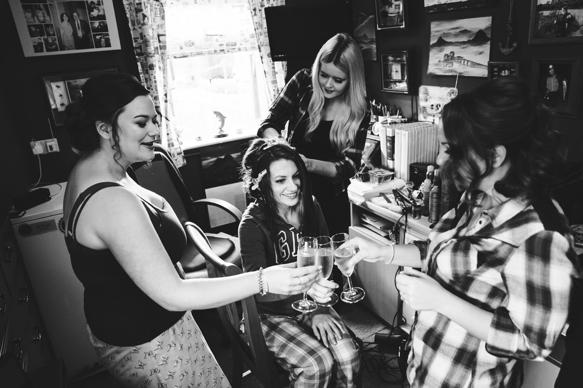 bridesmaids toast the bride during their bridal preparations at Sussex Barns wedding venue
