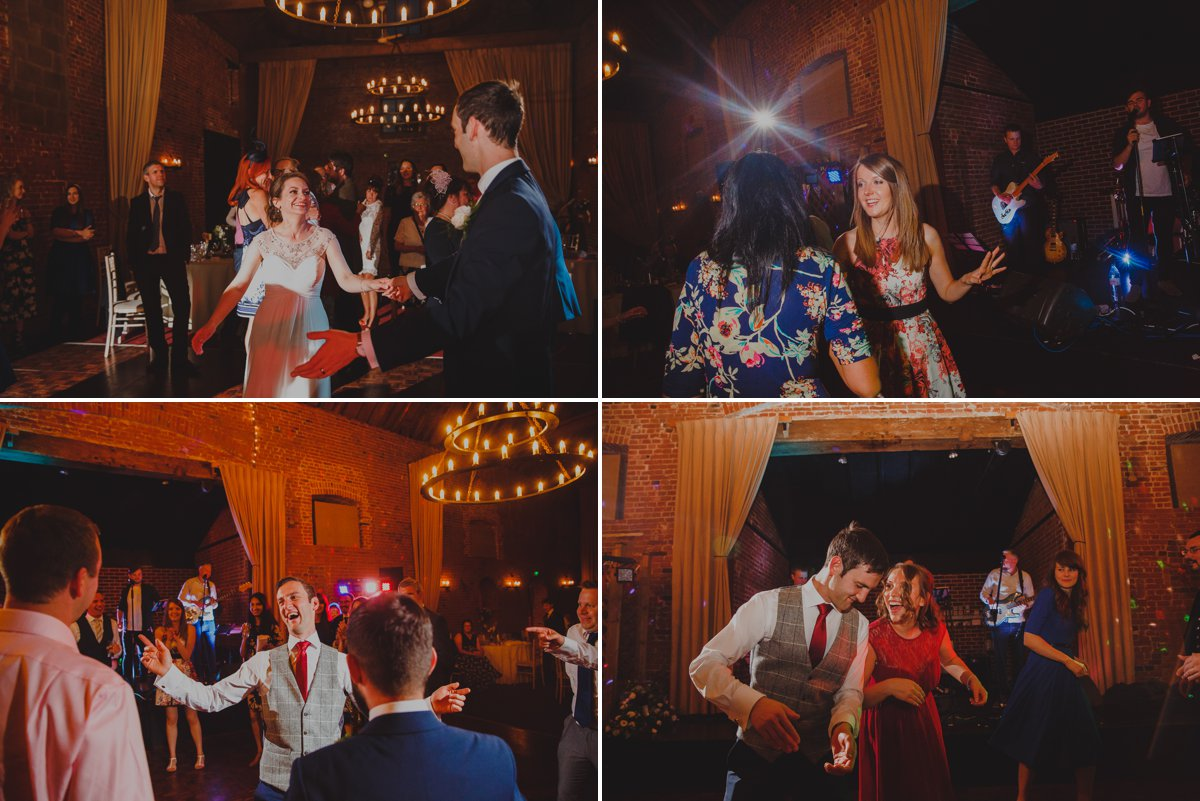 Wedding guests celebrating on the dancefloor at Sussex barn