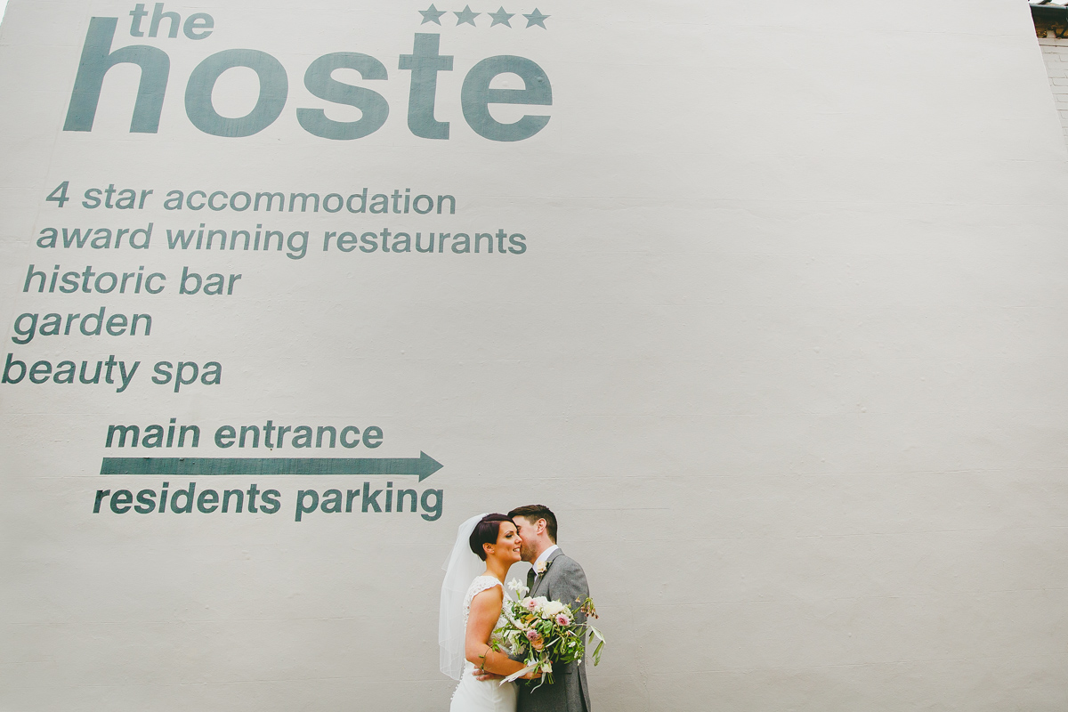 A bride and groom portrait outside the Hoste in North Norfolk