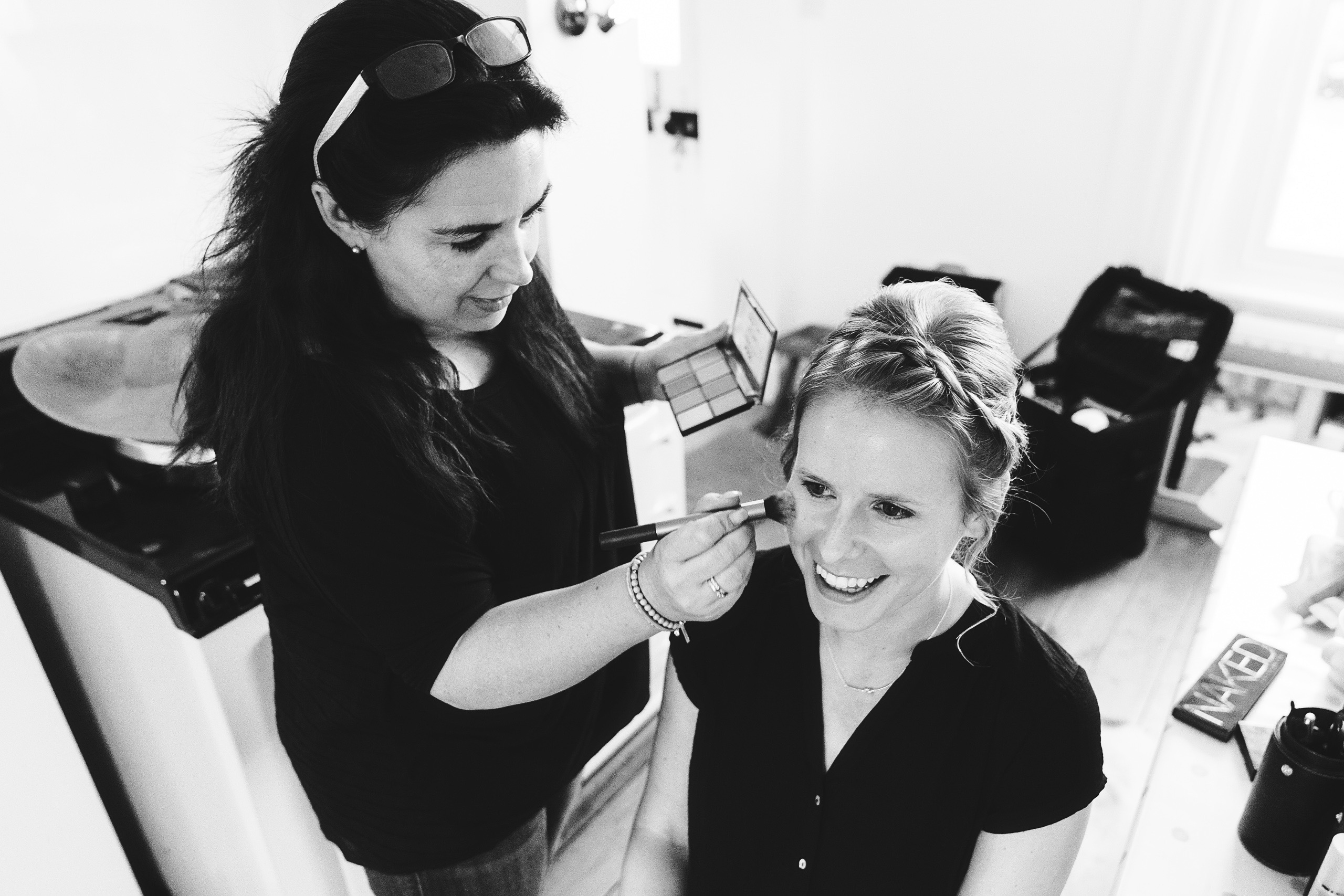 Norfolk makeup artist Amanda Steed applying bridal makeup at a Norwich wedding