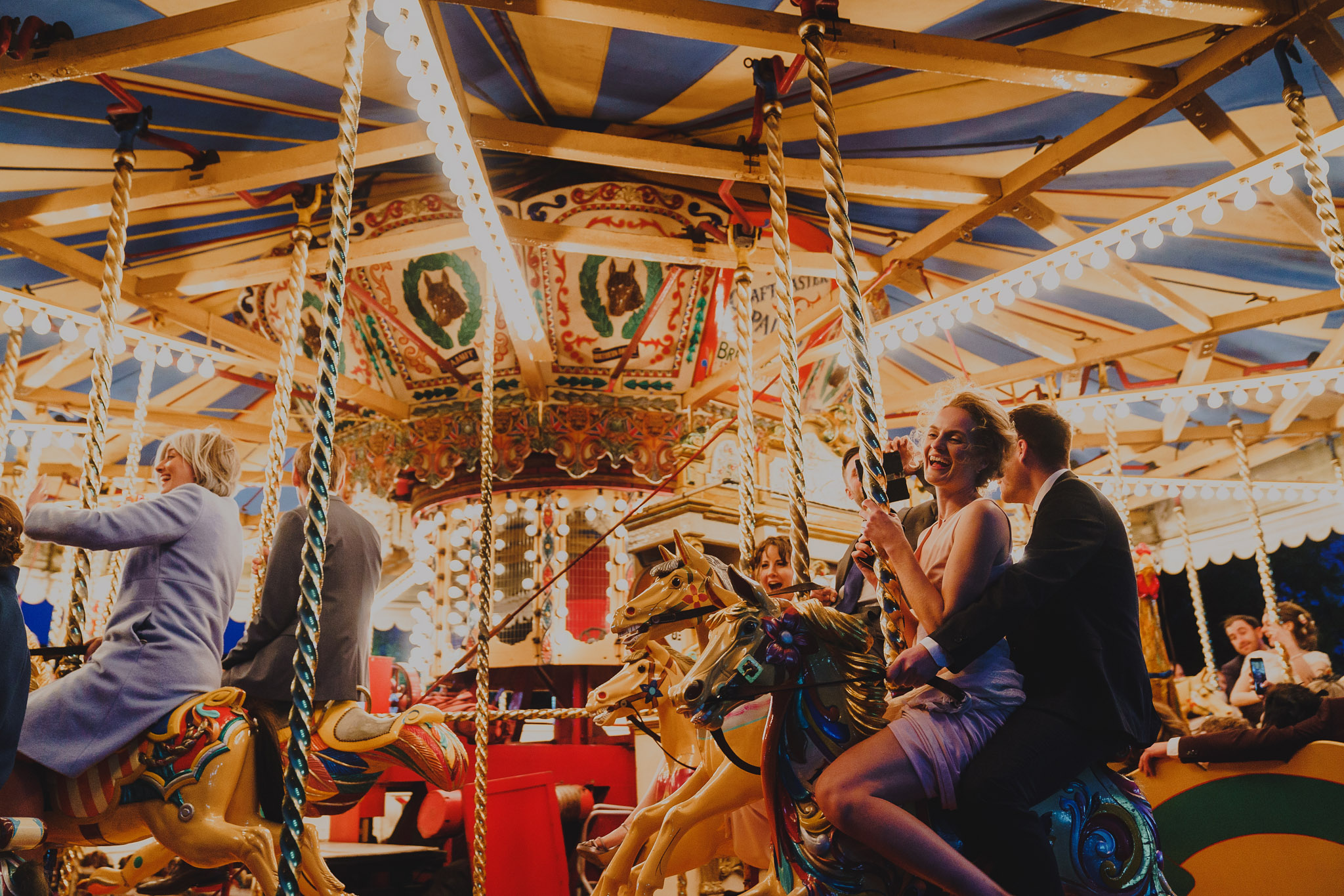 wedding guests enjoying the Gallopers carousel at Bressingham Hall, Norfolk