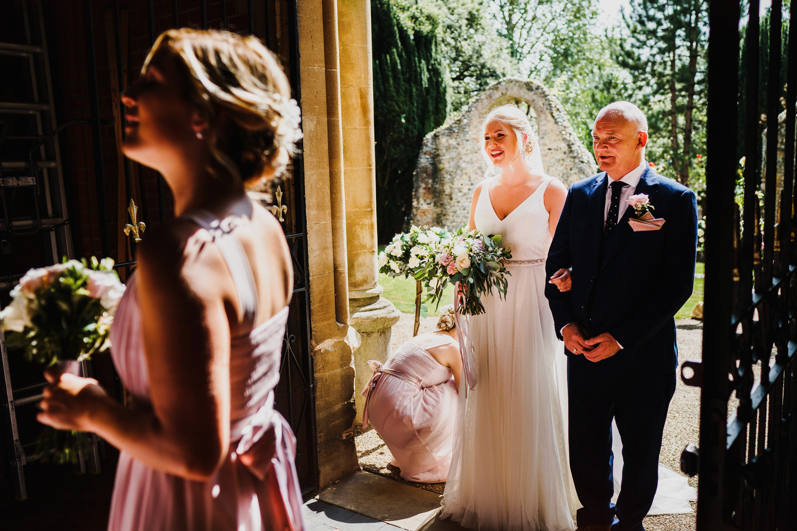 A bride waits outside Thorpe St Andrew church in Norwich, with her father, before walking down the aisle.