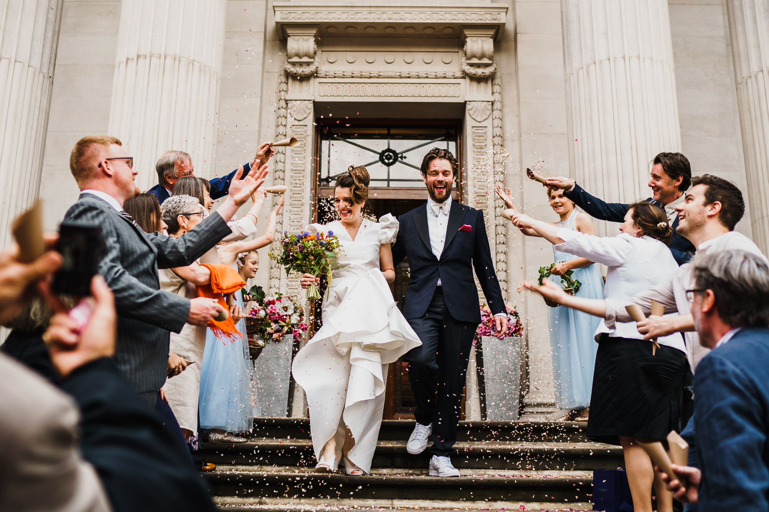 A newly married are showered with confetti at Old Marylebone Town Hall