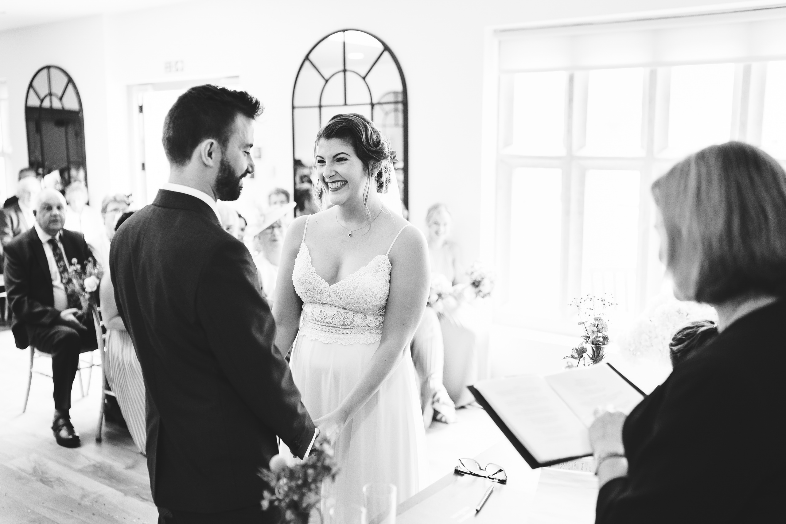 A bride and Groom saying their wedding vows at Oxnead Hall in Norfolk.