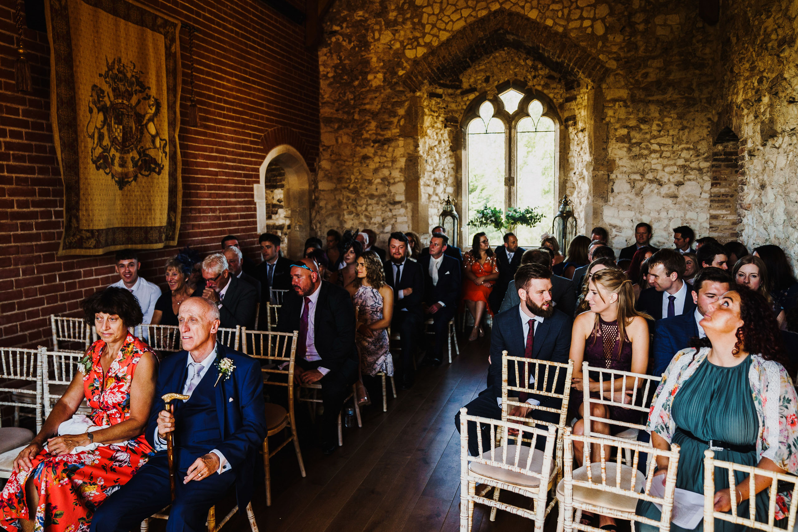 Guests wait for the bride to arrive at Pentney Abbey