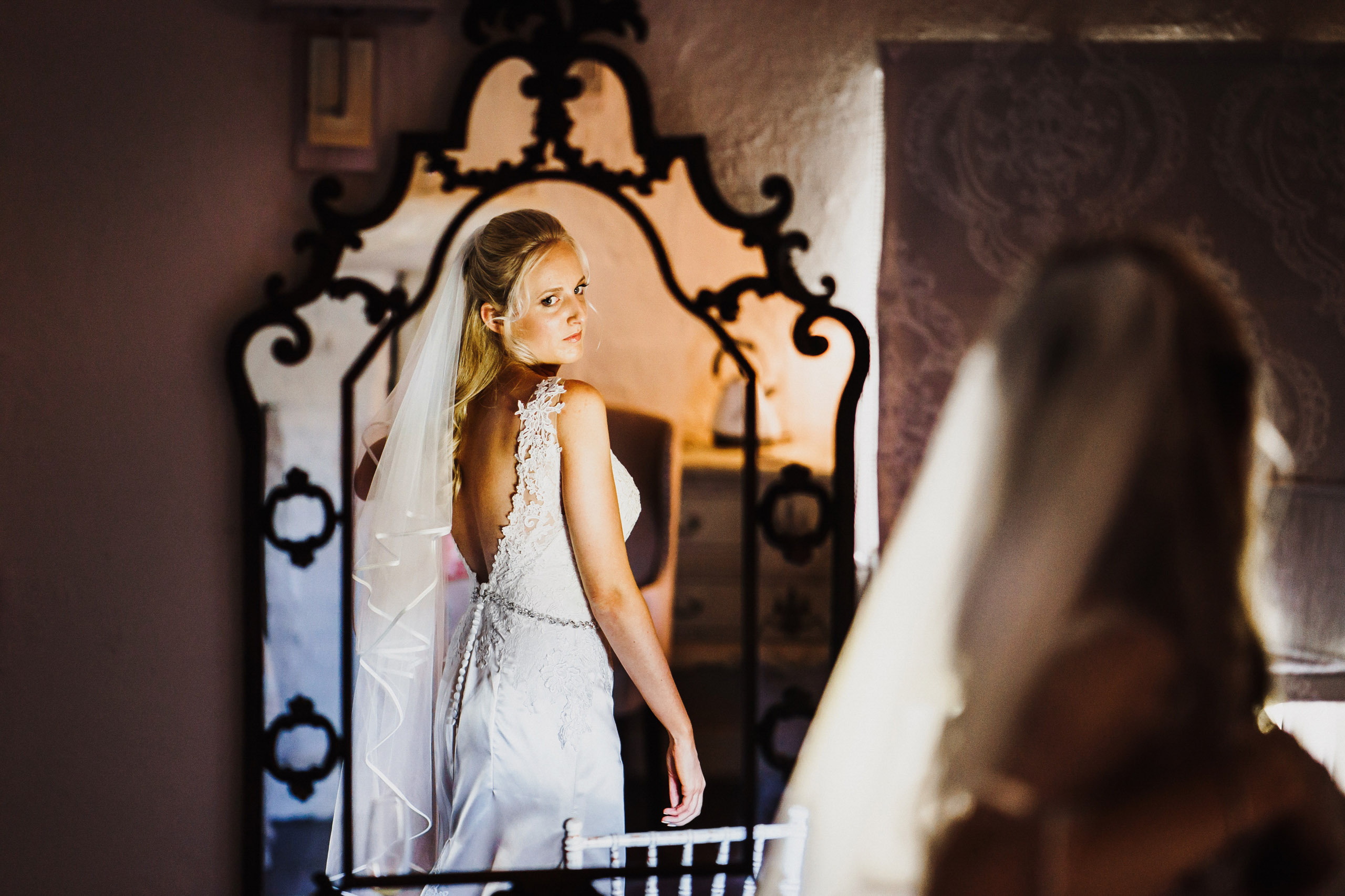 A bride reflected in a mirror at Pentney Abbey in Norfolk