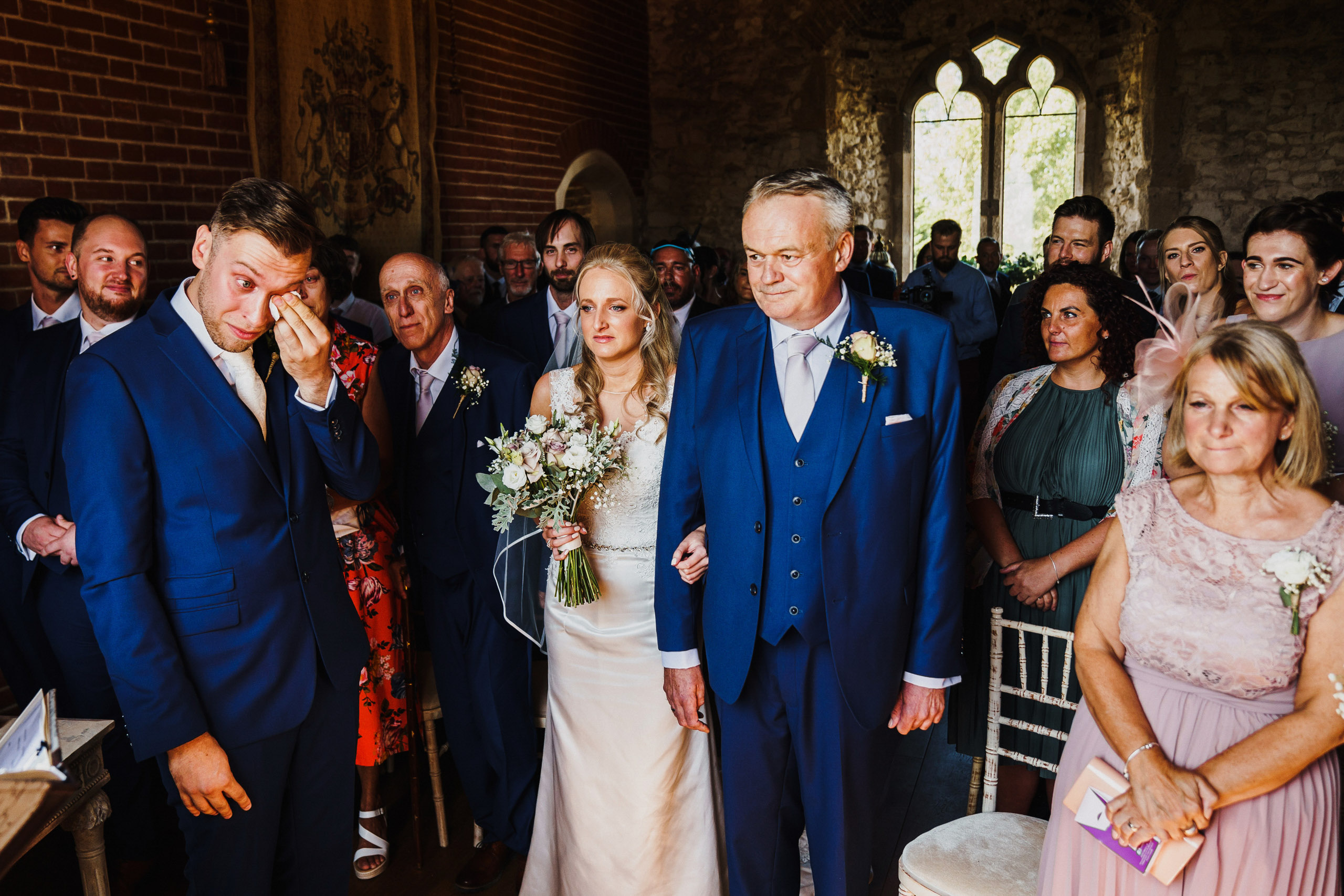 Groom drying his tears at Pentney Abbey