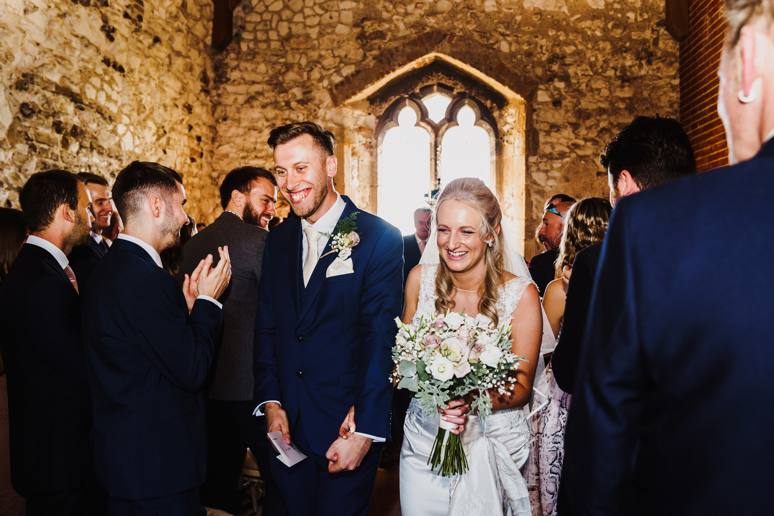 Bride and Groom walk back down the aisle at Pentney Abbey