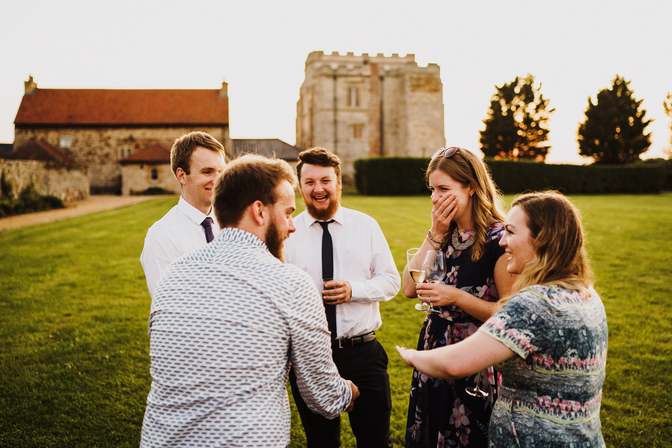 Weding guests in the gardens at Pentney Abbey Wedding venue