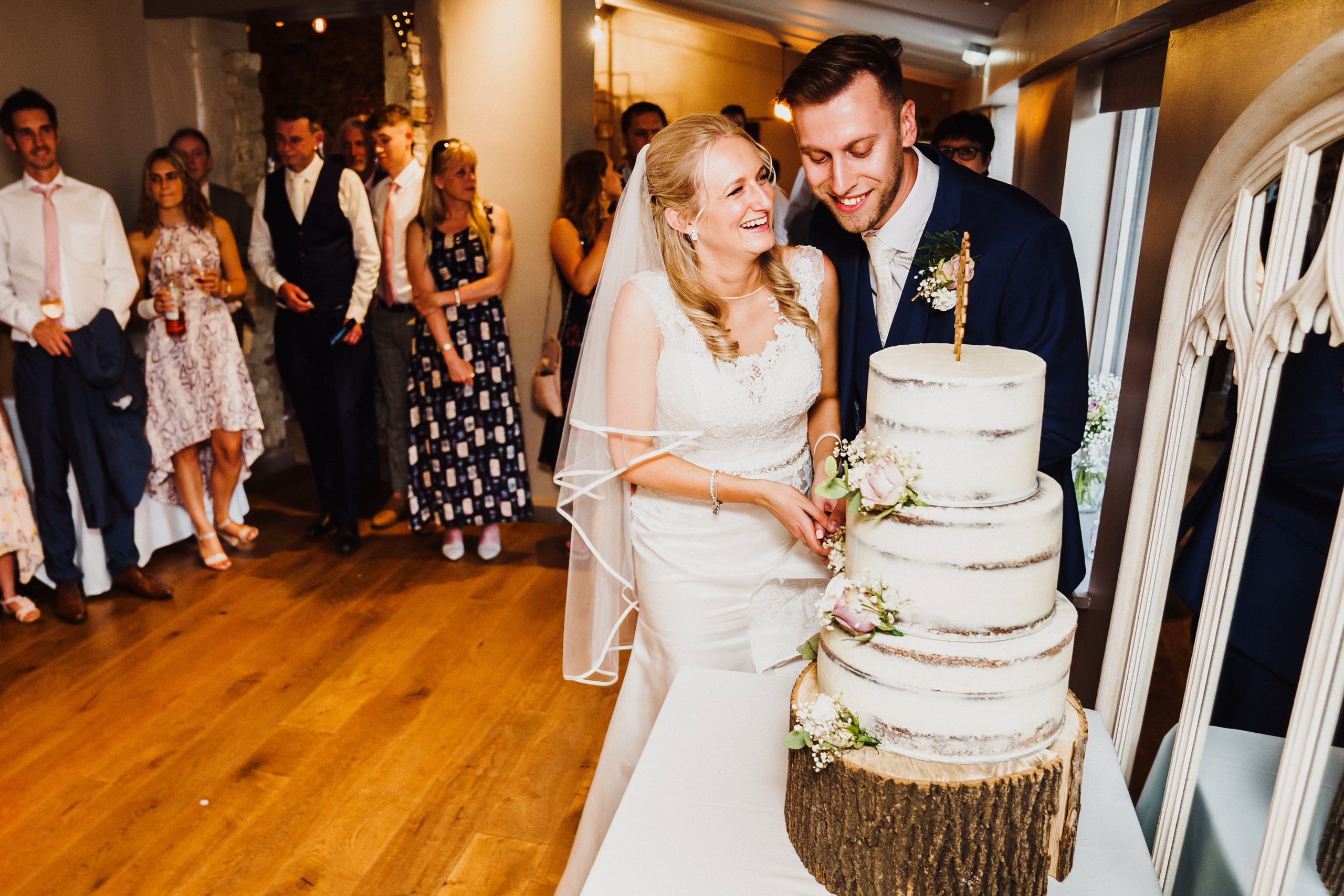 Bride and Groom cut their cake at a Pentney Abbey wedding