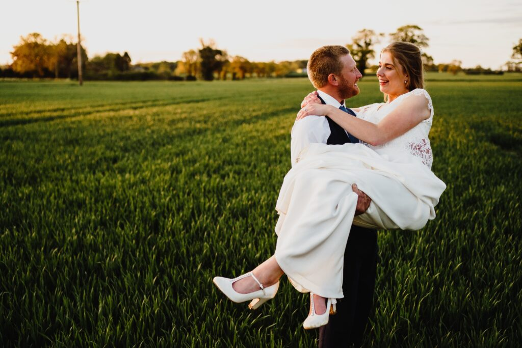 A bride and groom photographed by Norfolk Wedding Photographer, Rob Dodsworth, at last light at the Reading Room wedding venue near Norwich.