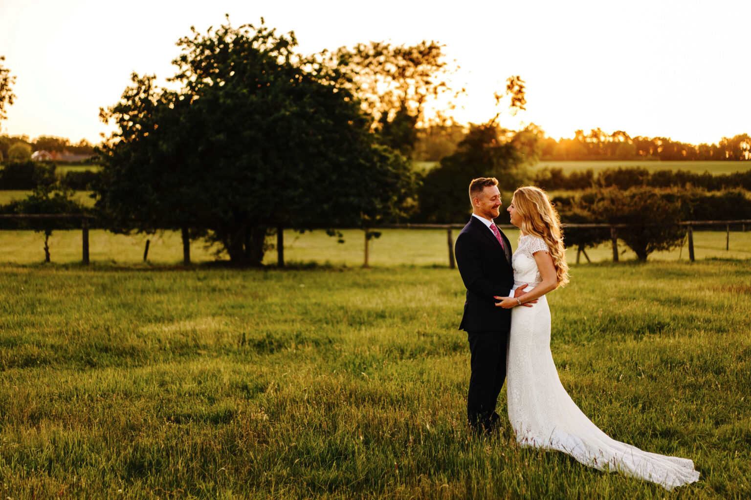 A bride and groom at sunset in Norfolk.